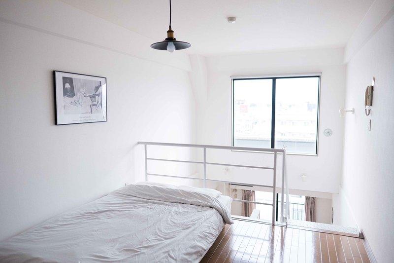 Well-lit bedroom with a view of Shimokitazawa.
