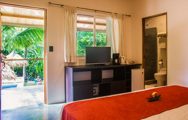 Standard King Room #7 at Fuego Lodge, CR, holiday rental in Carmen