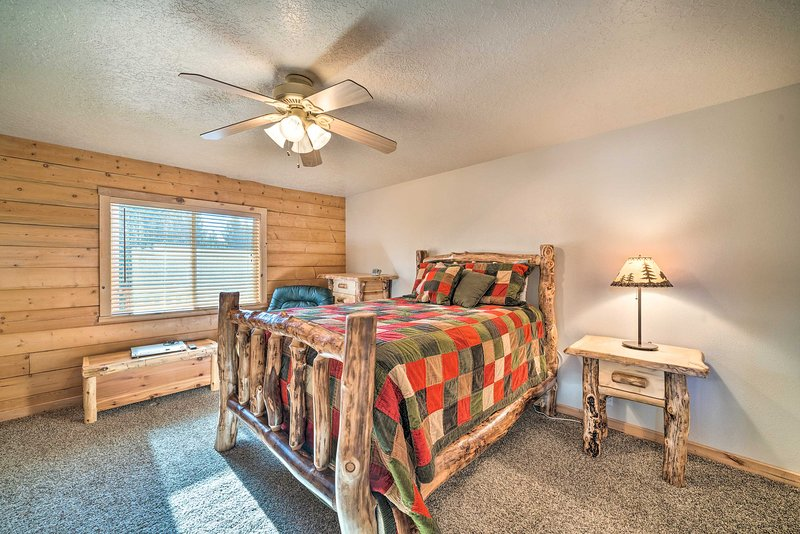 The master bedroom includes a queen bed.