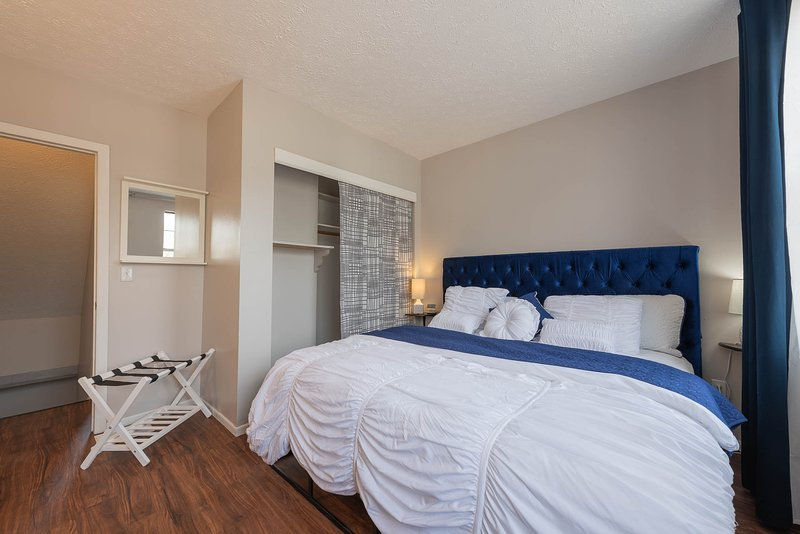 King bed, blackout curtains, small TV, USB ports in alarm clock, luggage rack, extra blanket.