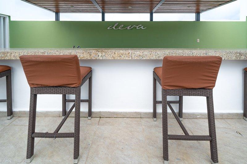 The Deva Condos community rooftop bar area with bathrooms