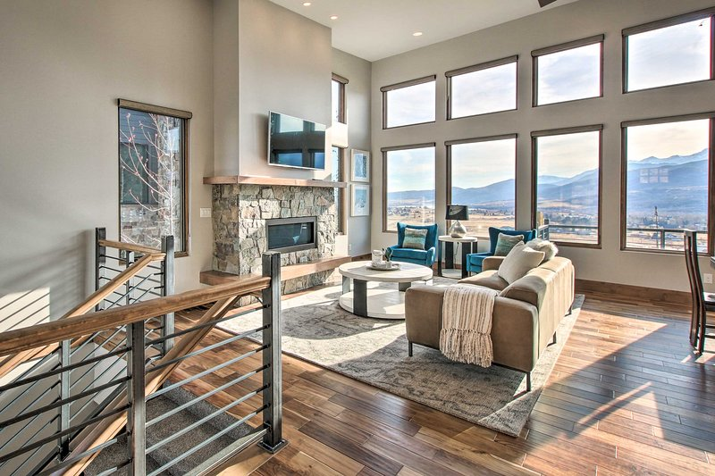 Relax by the warmth of the fireplace in this luxury living space.