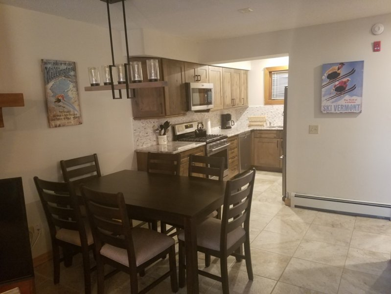New upscale kitchen with alder cabinets, granite, stainless appliances, flooring and furniture