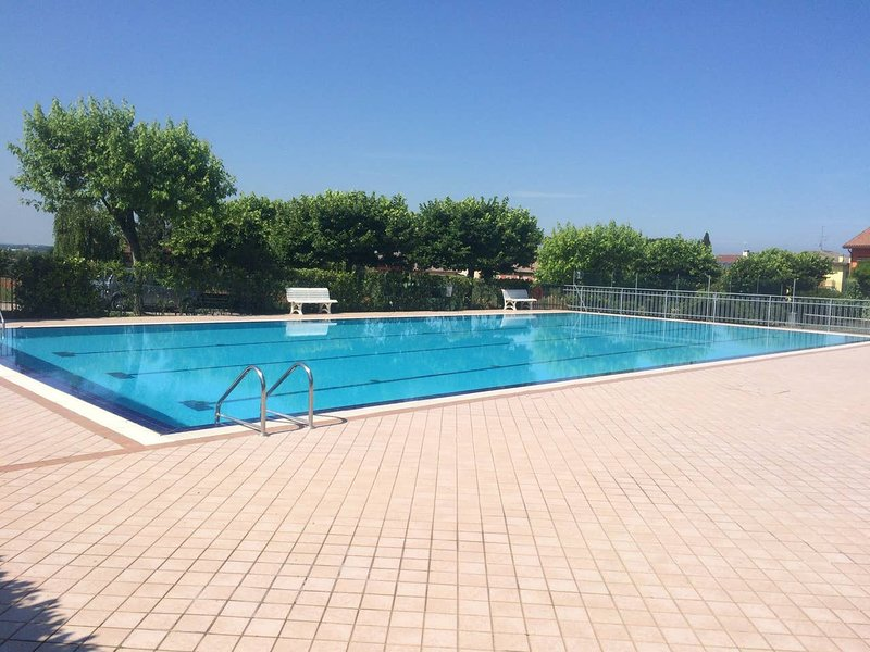 Apartment with shared pool, vacation rental in Cola