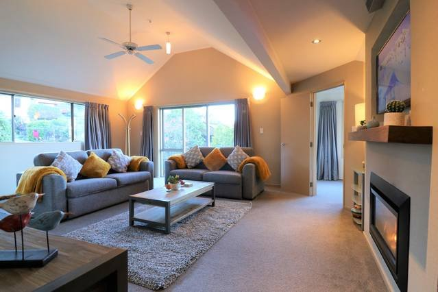 Large sofas, TV and Netflix, gas fire and great views towards the Remarkable Mountains, ensure a wonderful end of the day relaxing social space.