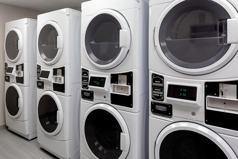 Self-serve laundry machines are available on-site.