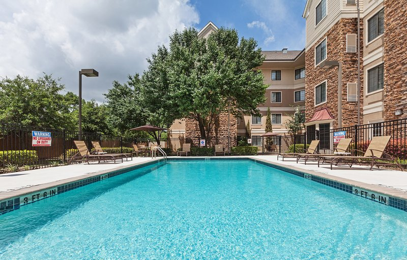 Dive into the outdoor pool on a hot summer day.