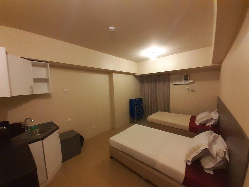 Twin Bed Studio Unit at Centrio Towers, alquiler vacacional en Cagayan de Oro