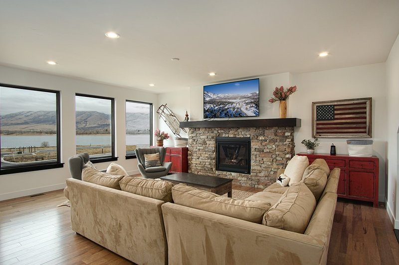 Main family Room with Gas Fire Place and beautiful Lake views