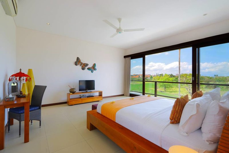 Upstairs bedrooms open to a balcony with the rice fields view from above