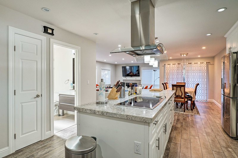 Stainless steel appliances and granite counters complete the kitchen.