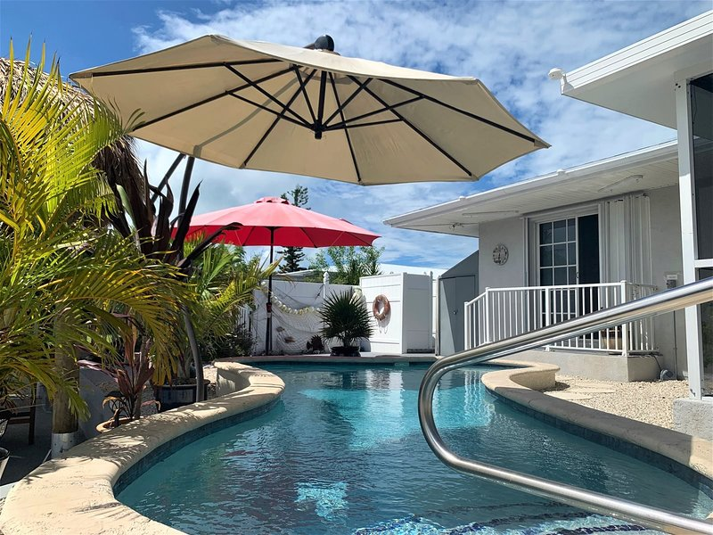 Manatee Oasis 3/2 Ground Level Home w/ Pool & 35` Dock, holiday rental in Grassy Key