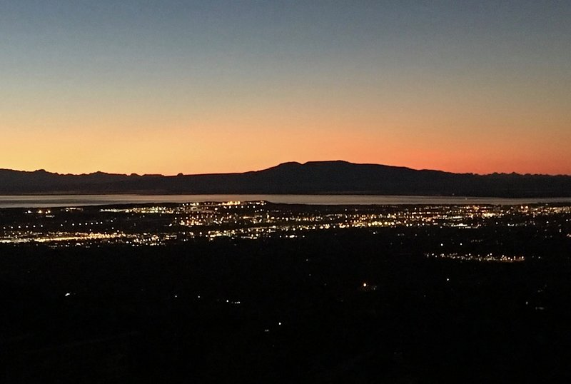 City lights, Sleeping Lady Mountain, and last light of the sunset.
