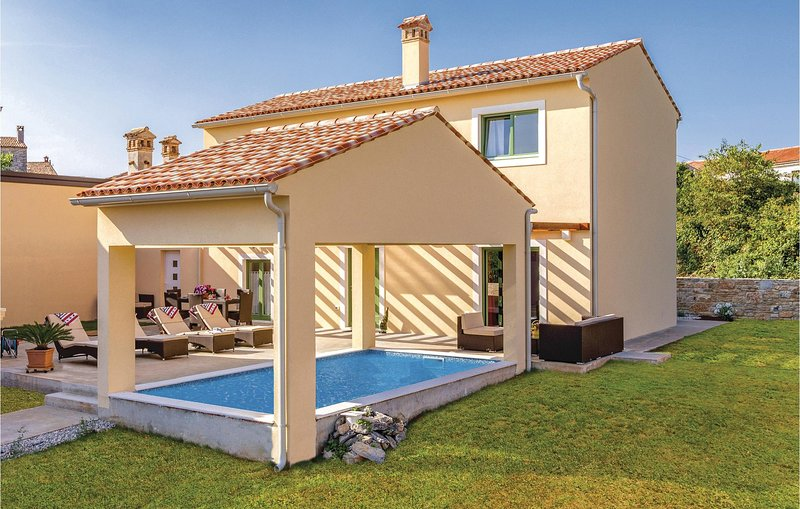 Amazing home in Bale with Outdoor swimming pool, WiFi and 2 Bedrooms (CIV715), vacation rental in Bale
