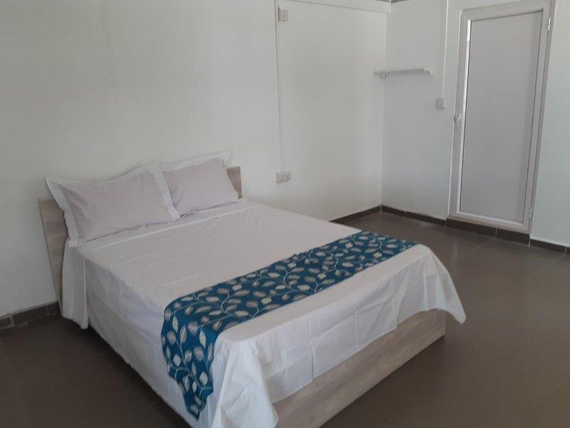 A room for two people at Palais Authentic, location de vacances à Pointe aux Canonniers