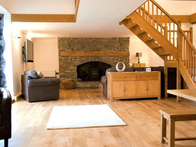 Deze prachtige lounge / diner is de perfecte ruimte om te genieten met familie en vrienden