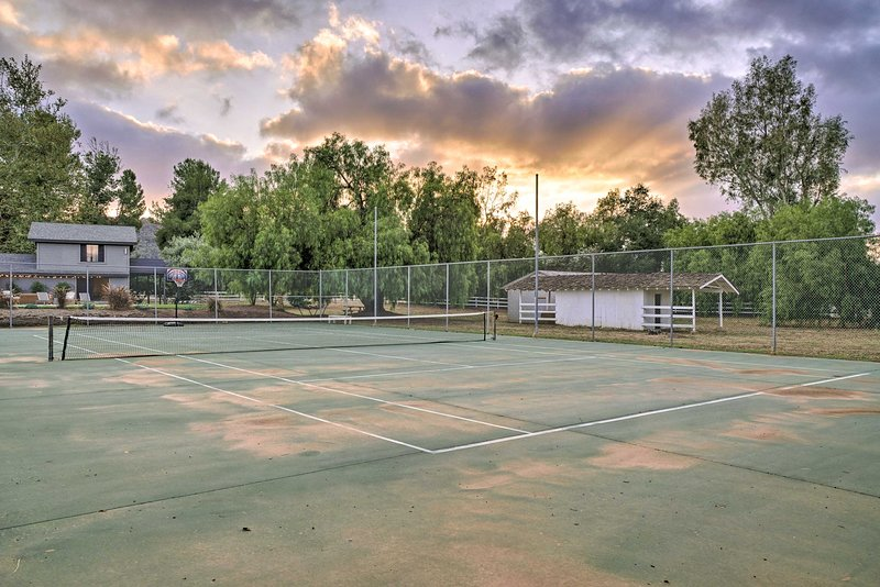 Practice your serve on the private tennis court!