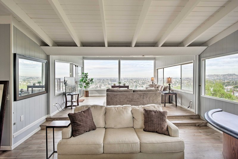 The open living room is illuminated with natural light.