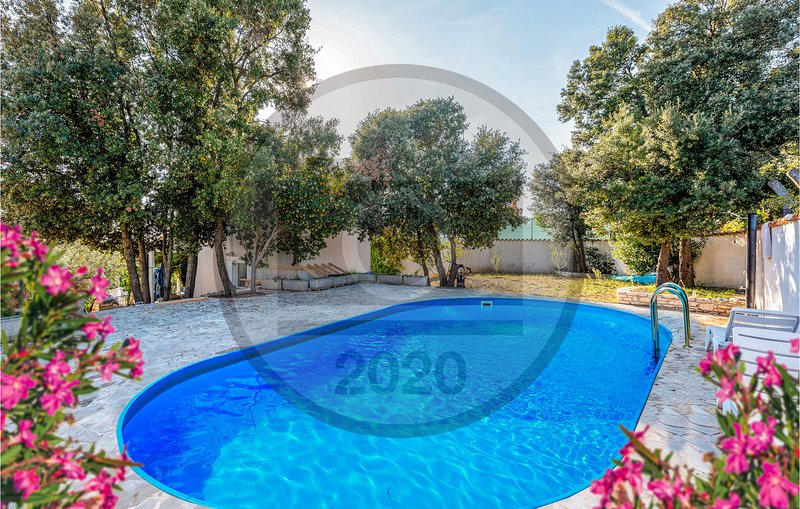 Beautiful home in Pavicini w/ Outdoor swimming pool and 3 Bedrooms (CIO225), holiday rental in Peruski