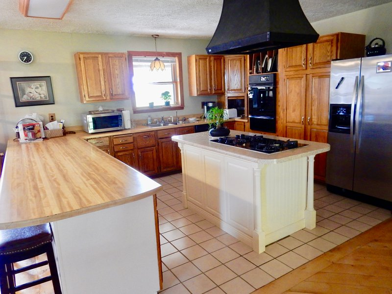 Spacious kitchen has all the appliances and cookware you need to make big meals!