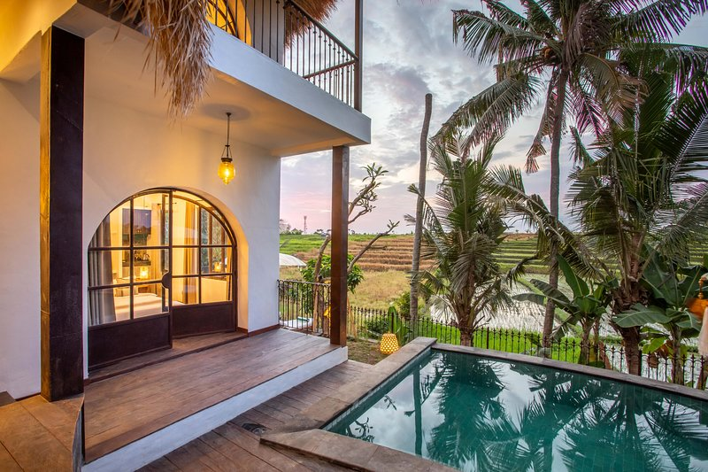 First bedroom in Yuka has direct access to the pool