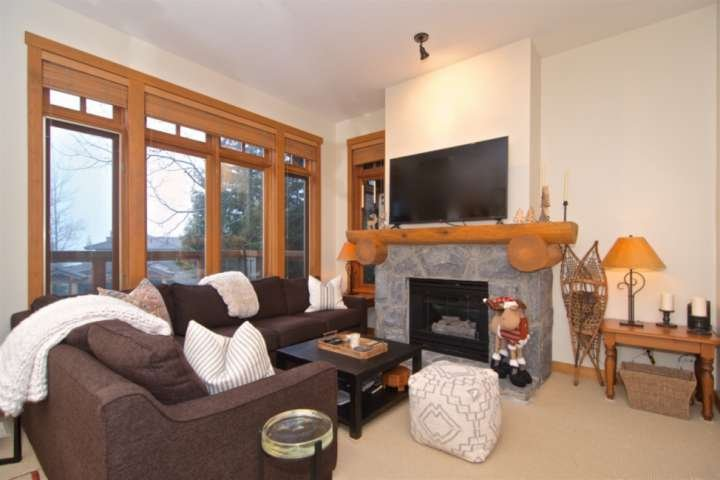 Comfortable living area with gas fireplace and large screen TV