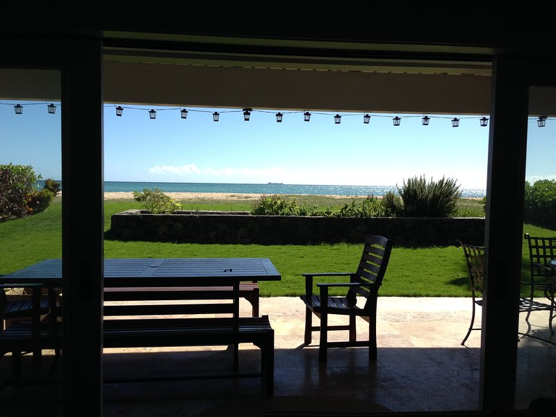 Looking out our living room at the herb garden to our sandy beach.