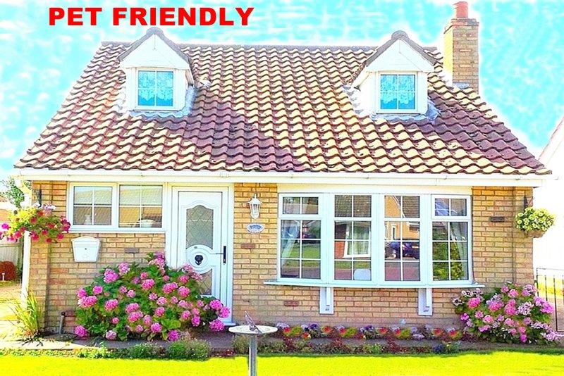 Adorerai questo cottage accogliente e familiare vicino al mare con un ampio giardino sicuro per animali domestici. Perfezionare