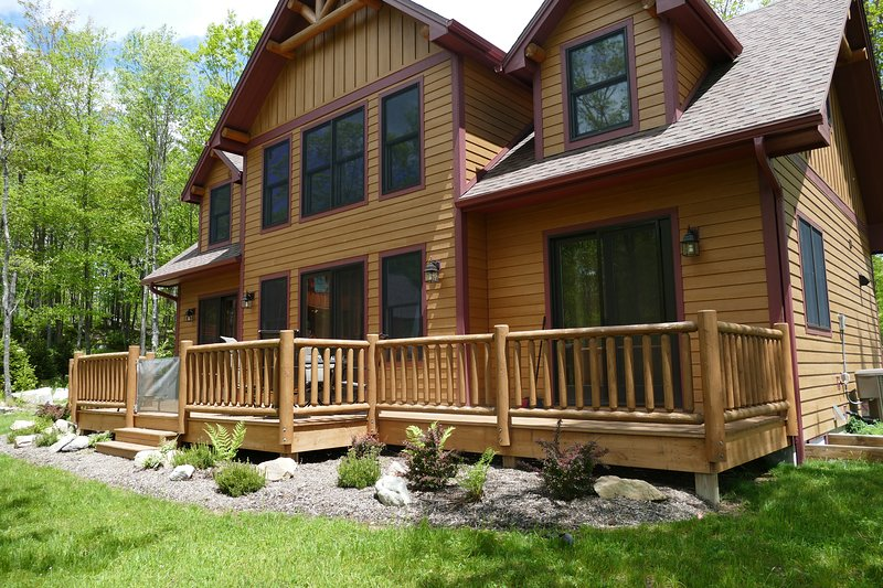 The large back deck and yard offers a nice place to retreat to