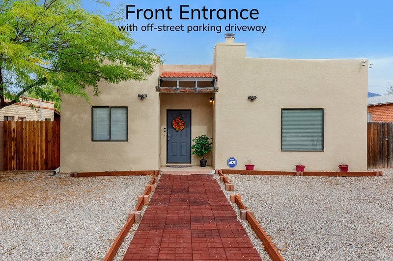 Front entrance with driveway for parking up to one vehicle.