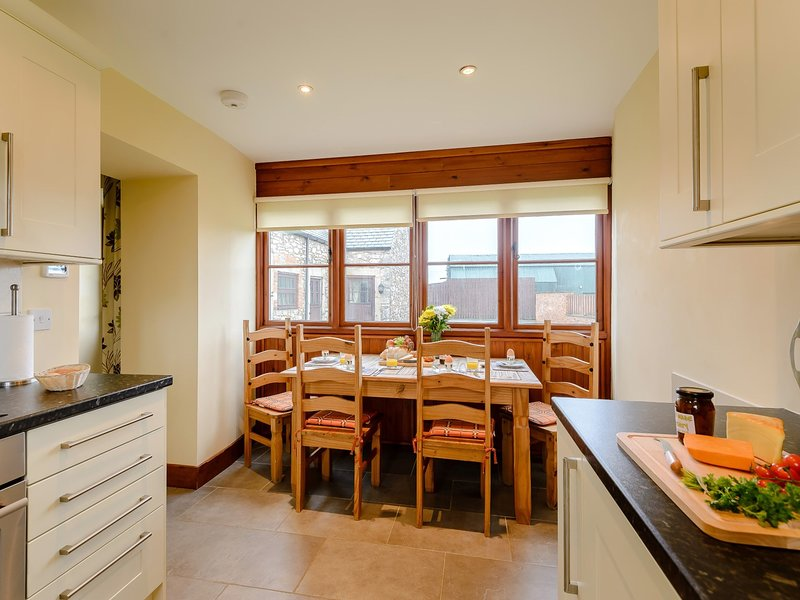 Natural light floods into the kitchen