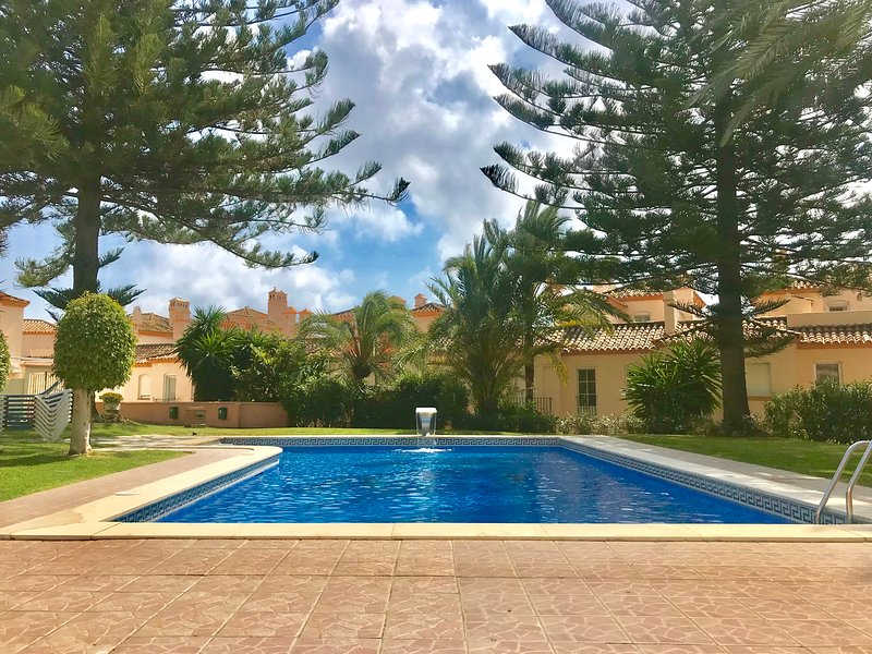Beautiful communal pool with beach access.