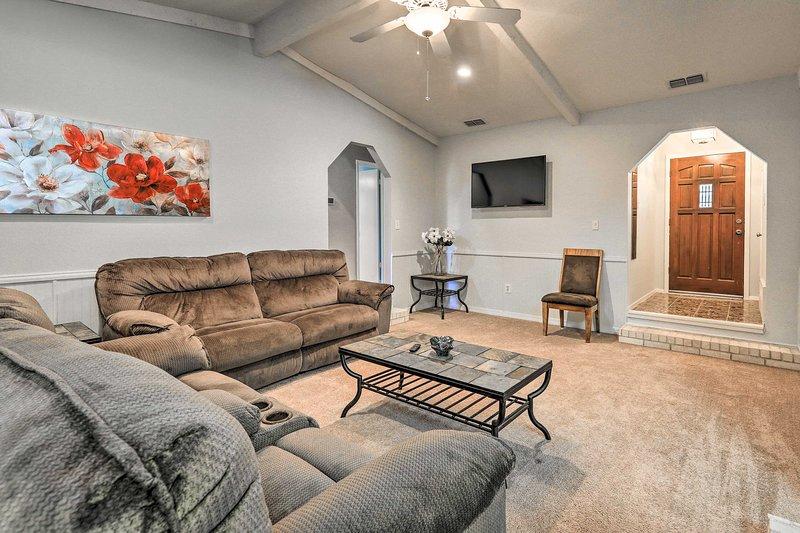Inside, this vacation rental boasts 3 bedrooms, 2 bathrooms, & sleeps 12 guests!