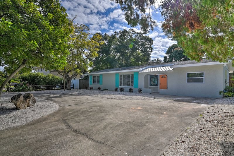 Experience the historic beach town of Bradenton at this tropical abode!