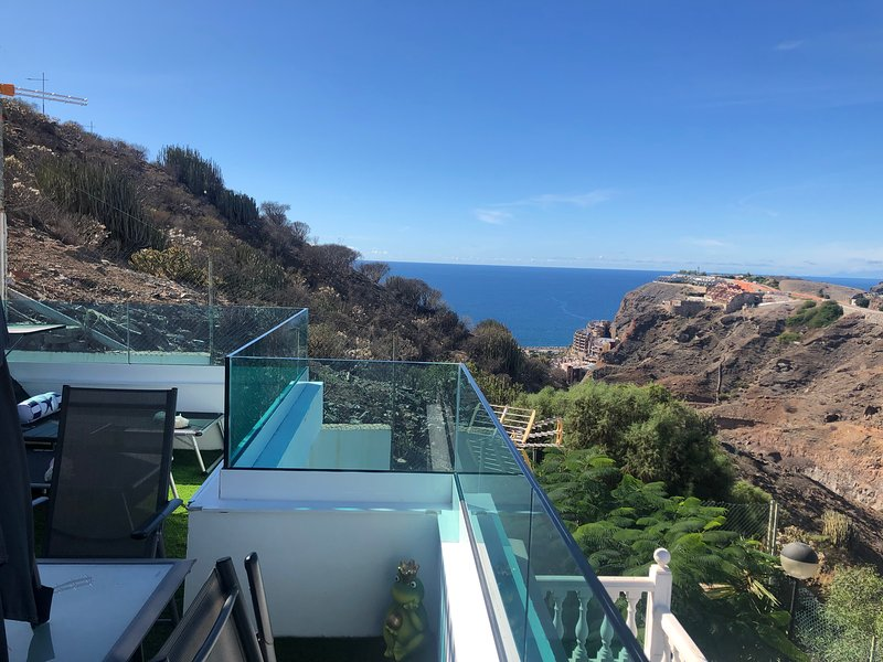Apartment with shared pool, holiday rental in Amadores