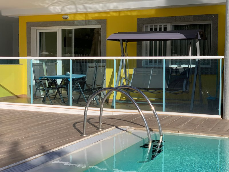 Private terrace, very close to the lovely pool. Full size dining table and luxury chair swing.