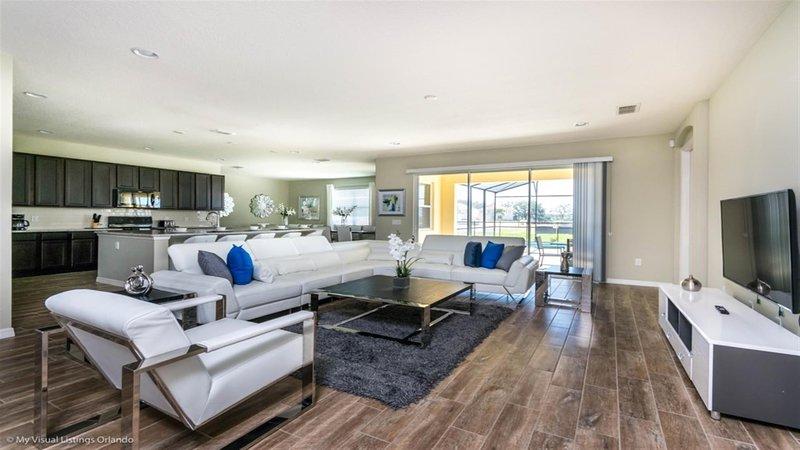 Living room & Kitchen - 8 Bedroom Villa Disney Vacation Rentals by Sweet Home Vacation