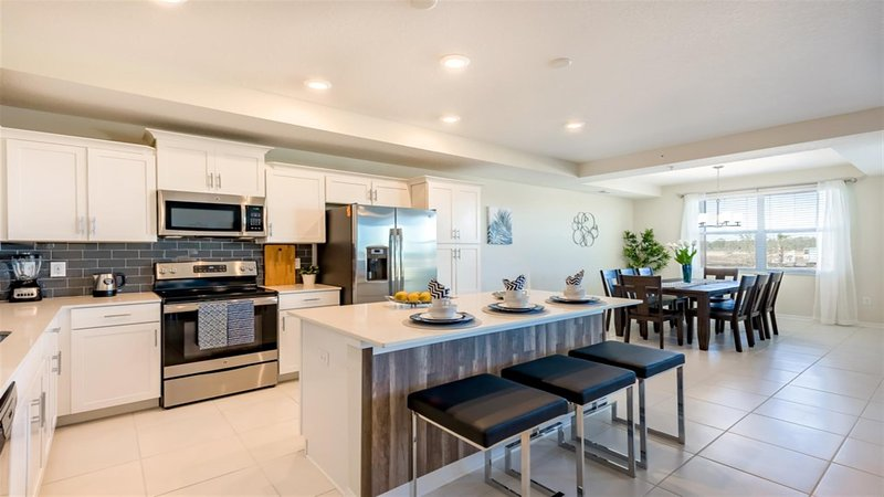 Kitchen And Dining Area- 2 Bedroom Apartment  Disney Vacation Rentals by Sweet Home Vacation