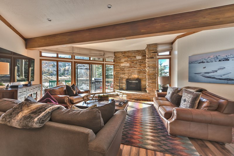 Living Room with Flat Screen TV, Wood Fireplace, New Queen Sleeper Sofa and Private Deck with Mountain Views!