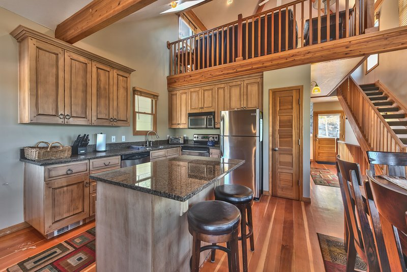 Enter on Level 3 (Main Level) with Kitchen, Dining and Sitting Areas with Hardwood Floors