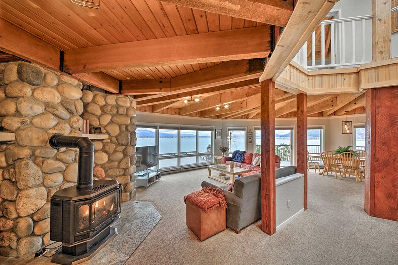 Vaulted ceilings and exposed wood beams create a cozy cabin ambiance.