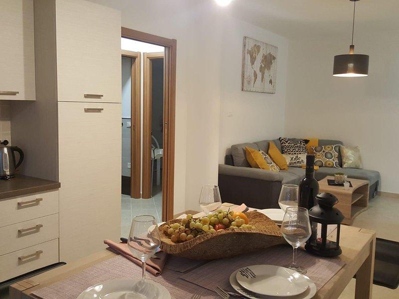 Olga modern apartment wit terrace not far from Alghero, vacation rental in Olmedo