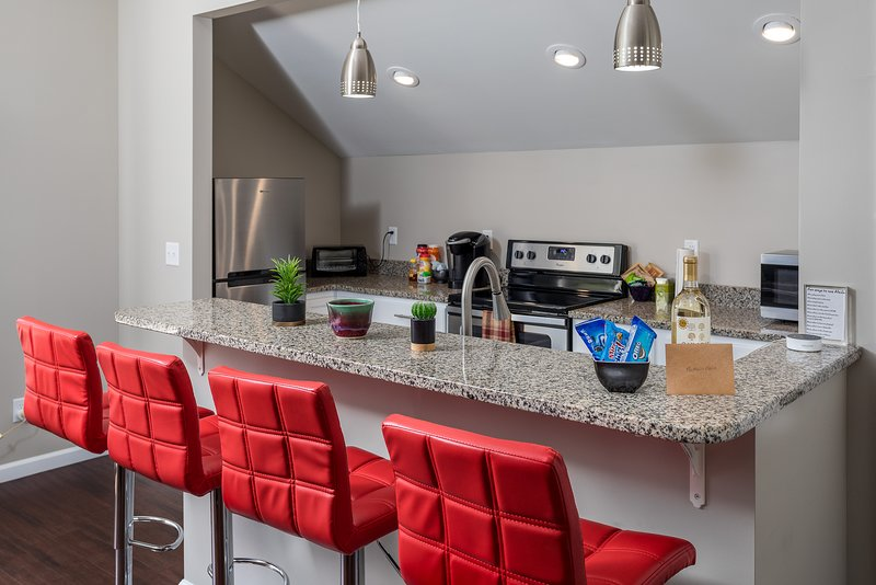 Full kitchen with bar