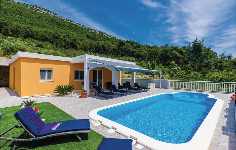 Nice home in Ston w/ WiFi, 3 Bedrooms and Outdoor swimming pool (CDP515), holiday rental in Ston