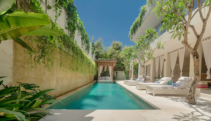 The Villa Savasana pool is lined in green stone with 'floating' bale and sun-beds