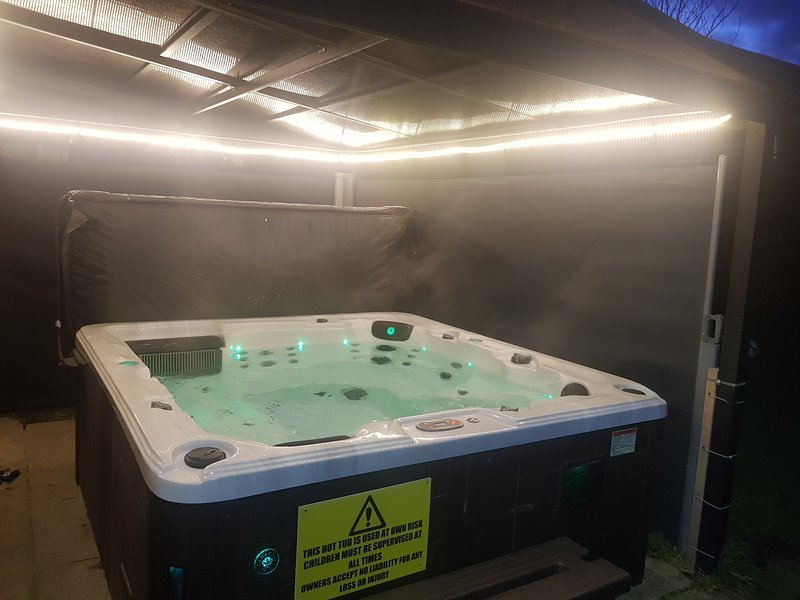 HOT TUB UNDER THE LIGHTS