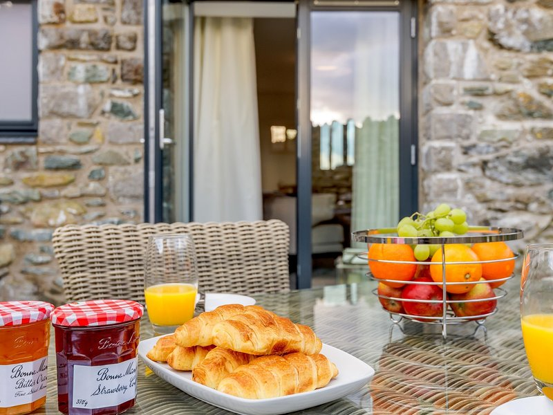 Walk through the French doors to the garden for a bite to eat in the sunshine