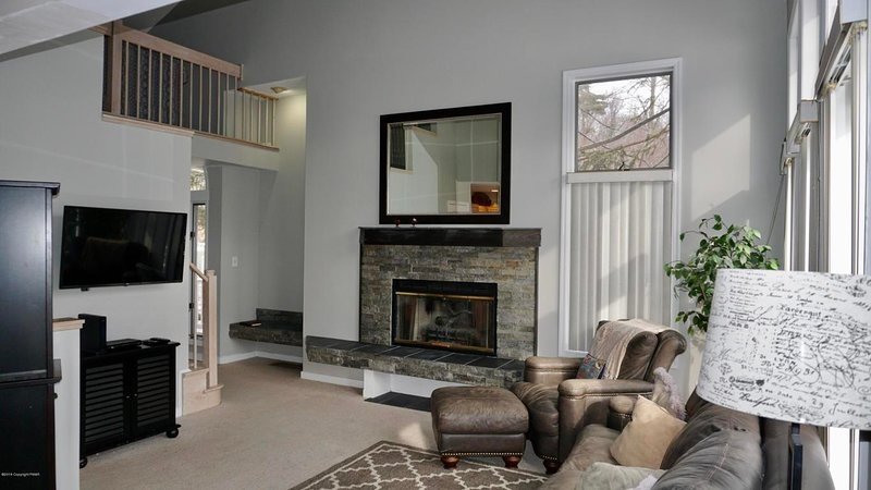 Living room with fireplace and large flat screen tv