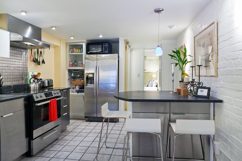 Eat in kitchen, stocked with dishware, pots, pans. Coffee & tea, plus extras