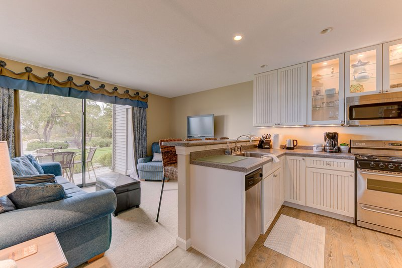 Enjoy sandy beach vibes and views of the lake while you cook in the full kitchen.